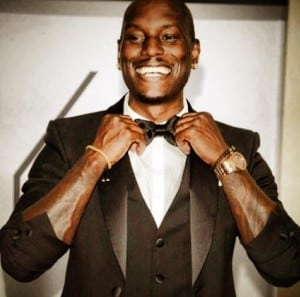 Tyrese Gibson smiling in a tuxedo