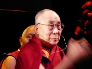 The Dalai Lama waves to the crowd.