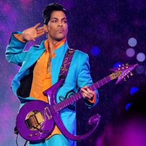 Prince with purple symbol guitar